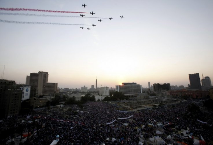 Egyptian military jets fly over Tahrir square full of anti-Morsi supporters (Reuters)