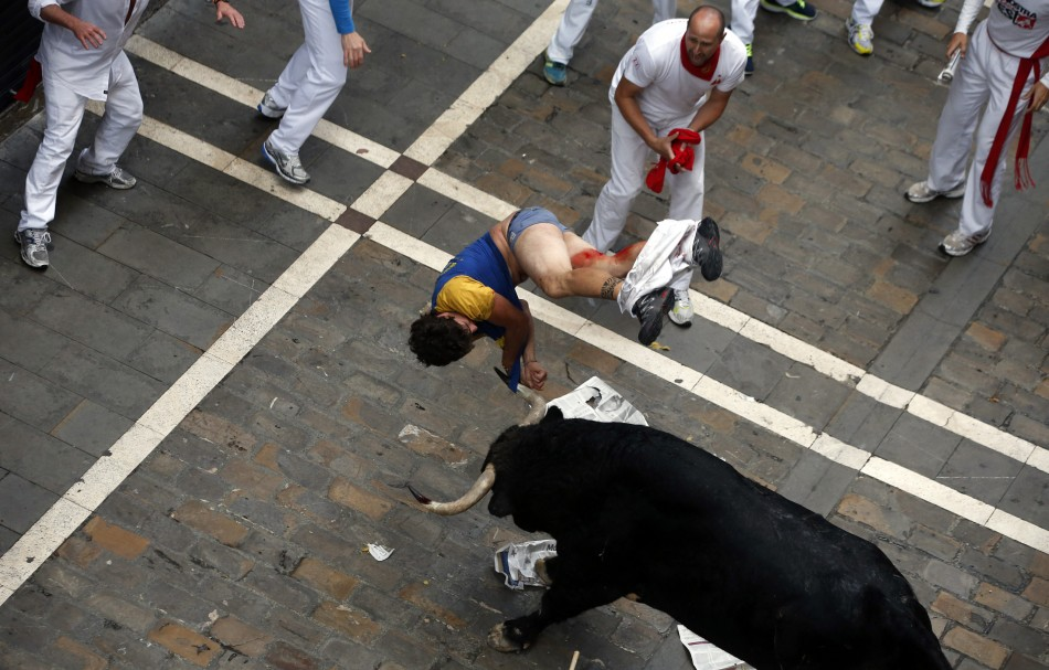 The runner was taken to hospital for his injuries (Reuters)