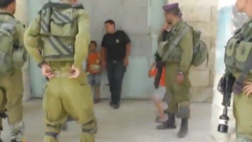 Wadi Maswadeh, 5, is detained by Israeli troops.
