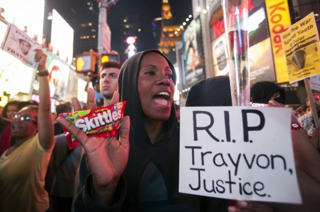 Protester Keisha Martin-Hall holds a bag of Skittles as she participates in a rally in response to the acquittal of George Zimmerman in the Trayvon Martin trial in Times Square