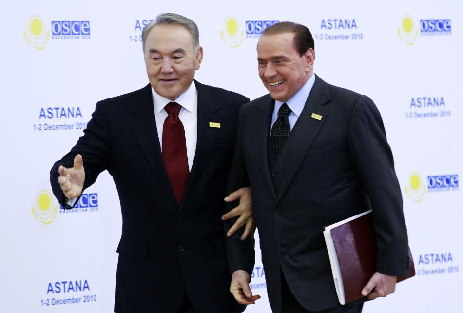 Kazakhstan's President Nursultan Nazarbayev welcomes Italy's Prime Minister Silvio Berlusconi (R)