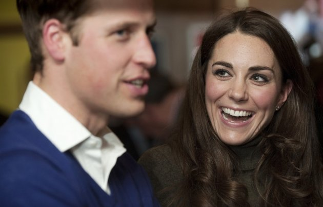 Prince William (2nd R) and his wife Catherine, Duchess of Cambridge
