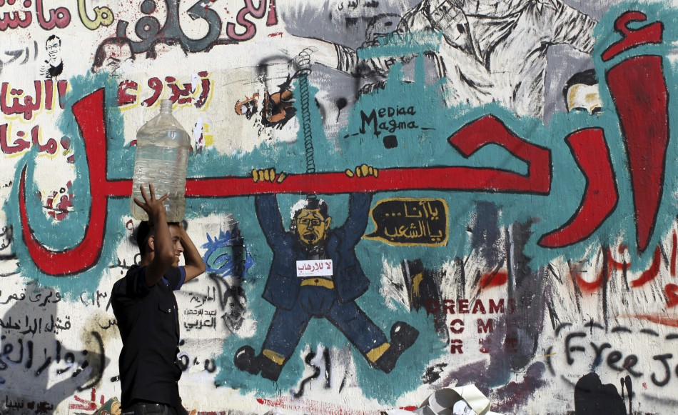 A wall filled with graffiti depicting deposed Egyptian President Mohamed Mursi with a message reading