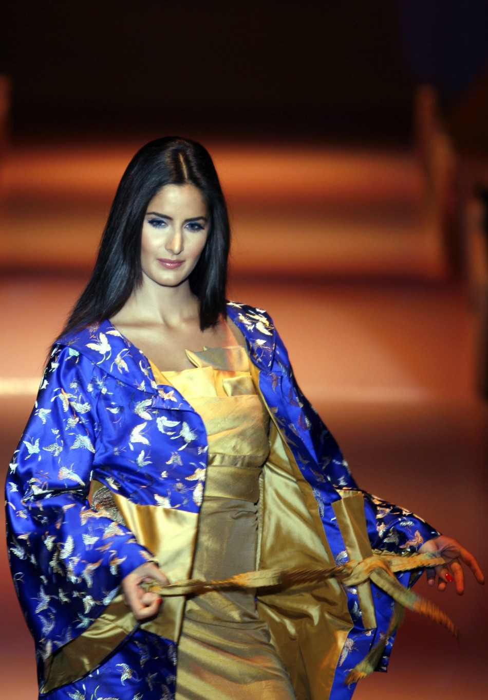 Kaif displays an outfit by Indian designer Narendra Kumar during the grand finale of India fashion week in Mumbai March 31, 2007.
