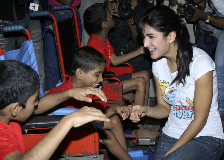Kaif R speaks with disabled children who came for a special screening of her movie De Dana Dan at a multiplex in Mumbai December 4, 2009.