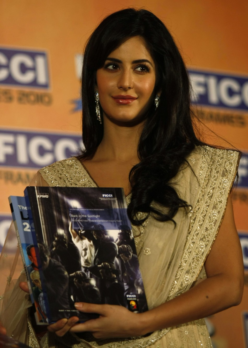 Kaif holds a yearbook during its release at the inauguration session of the 11th FICCI-FRAMES convention in Mumbai March 16, 2010.