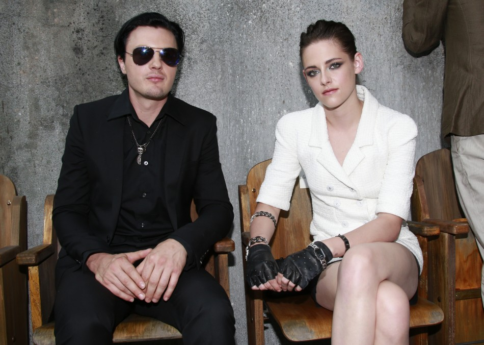 Kristen Stewart (R) and actor Michael Pitt pose before the Haute Couture Fall Winter 2013/2014 fashion show by German designer Karl Lagerfeld for French fashion house Chanel in Paris July 2, 2013.