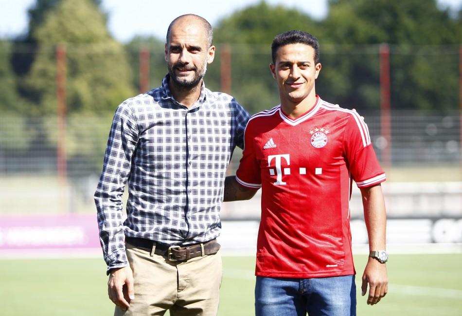 Pep Guardiola and Thiago Alcantara (R)
