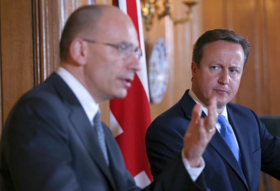 Britain's Prime Minister David Cameron (R) and Italy's Prime Minister Enrico Letta