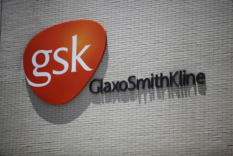 The logo of GlaxoSmithKline (GSK) is seen on its office building in Shanghai