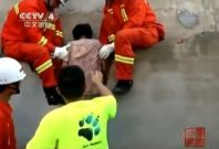 Firefighters rescue Chinese woman stuck between walls