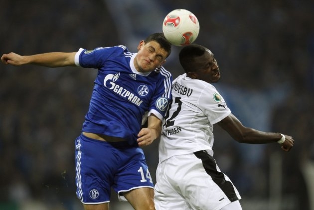 Kyriakos Papadopoulos (L) and Kingsley Onuegbu