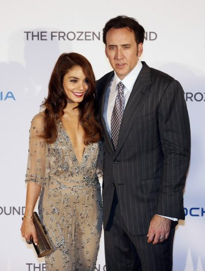 Actor Nicolas Cage R and actress Vanessa Hudgens