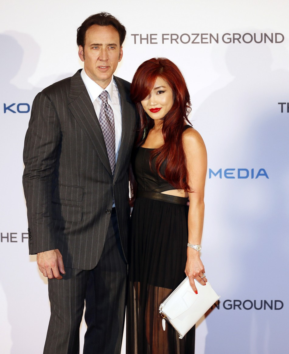 Actor Nicolas Cage L and his wife Alice Kim