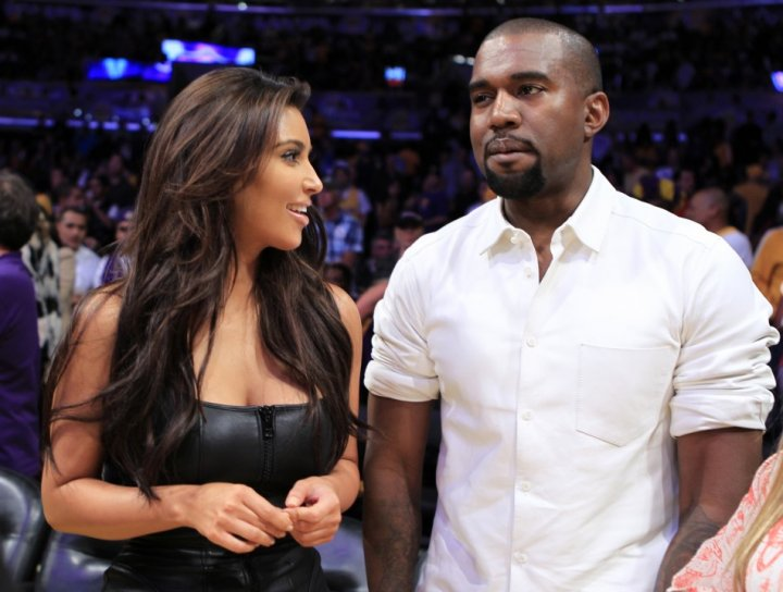 Kim Kardashian (L) and Kanye West `