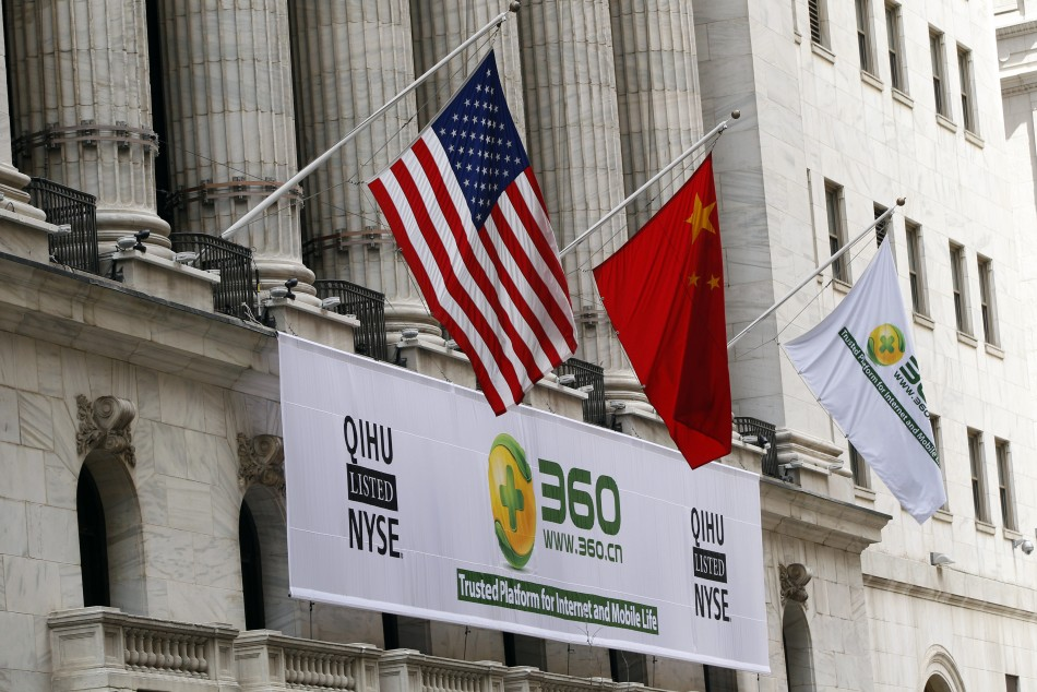 A sign advertising the Qihoo 360 Technology is hung with the U.S. and Chinese flags outside of the New York Stock Exchange.