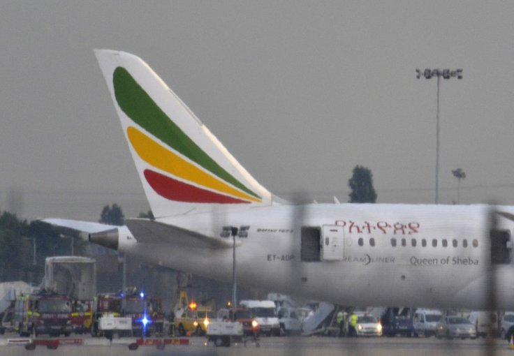 Emergency services attend the Ethiopian Airlines Dreamliner after a fire breaks out on board.