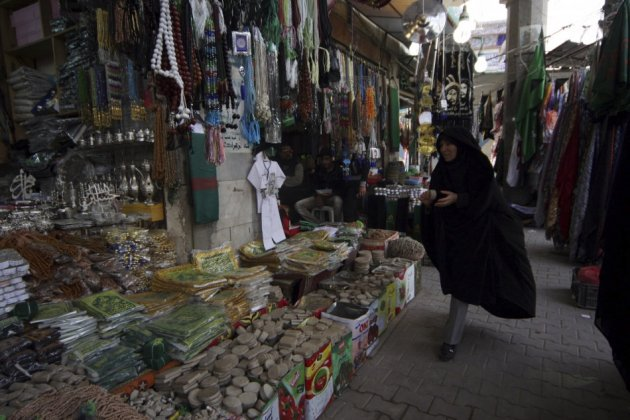 An Iranian woman shops at a market in Baghdad
