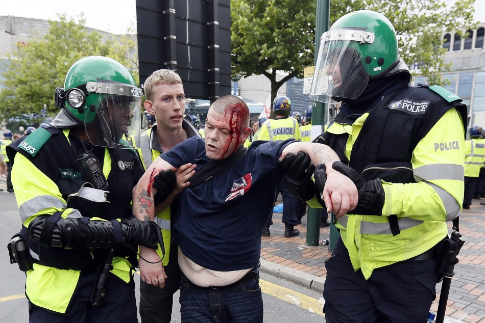 An EDL supporter is led away by police after a protest in Birmingham