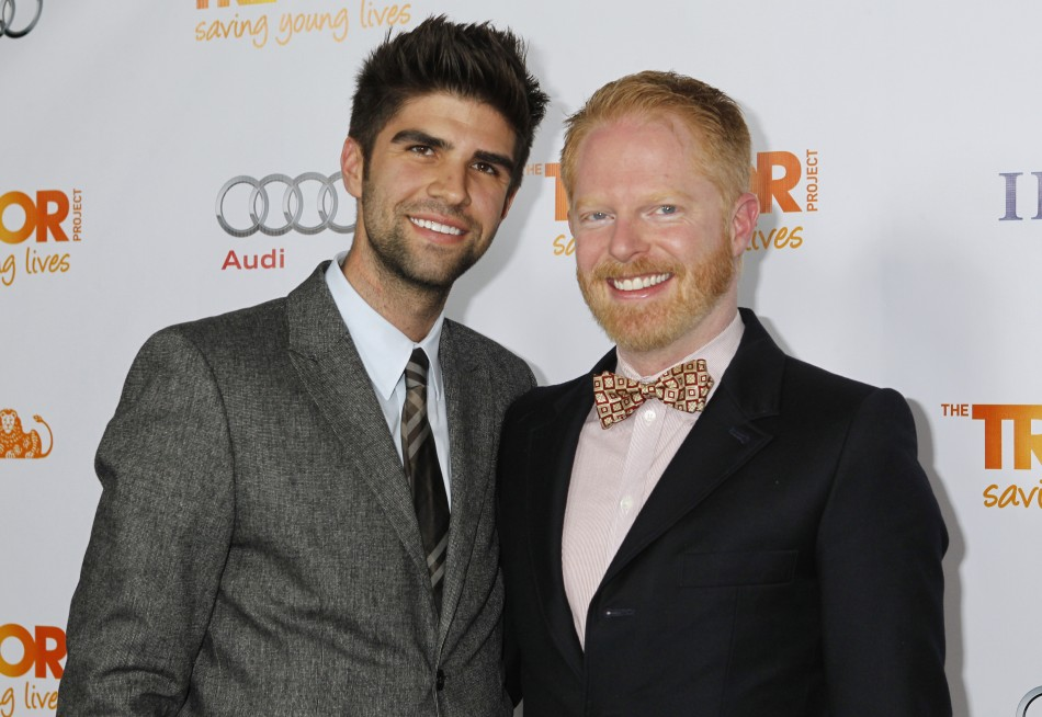 Actor Jesse Tyler Ferguson (R) and his partner Justin Mikita