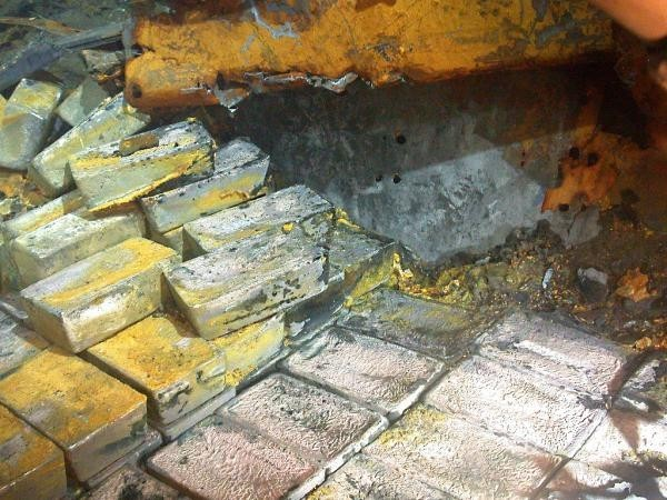 Discovery of buried silver treasure on the SS Gairsoppa. It is the heaviest and deepest recovery of precious metals from a shipwreck. (Odyssey Marine Exploration)