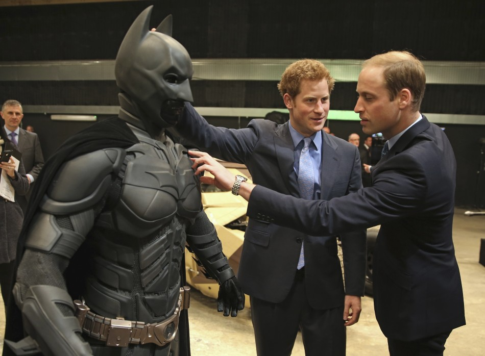 Prince Harry and Prince William Checking out an earlier version of the Batman suit