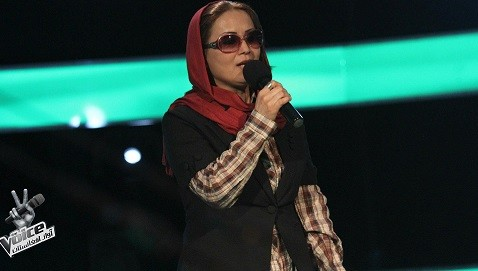 A female contestant performs on the Voice of Afghanistan (Facebook)