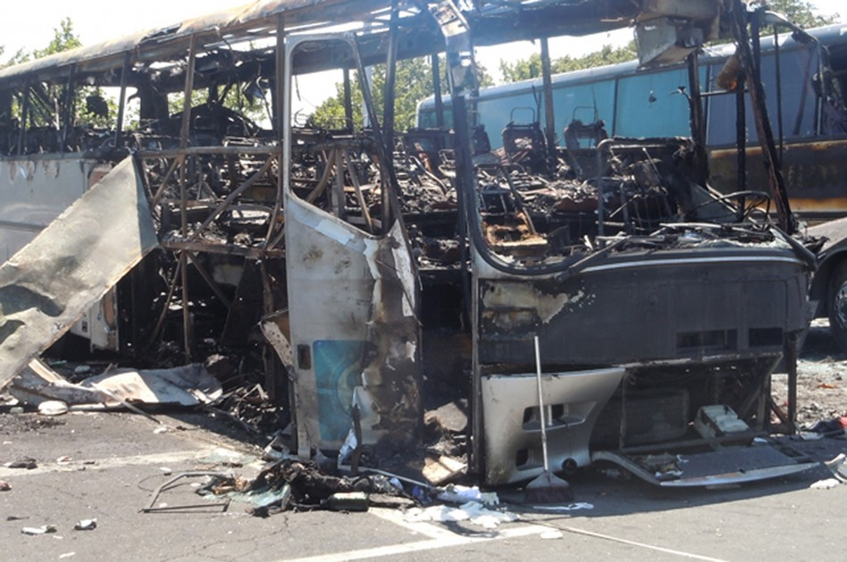 Buses that were damaged in a bomb blast on Wednesday are seen outside Burgas Airport