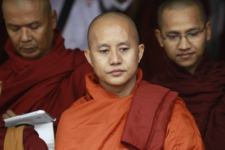 Buddhist monk Wirathu (C), leader of the 969 movement, greets other monks