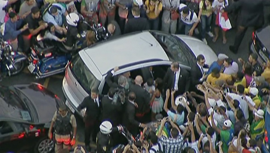 Pope's car mobbed