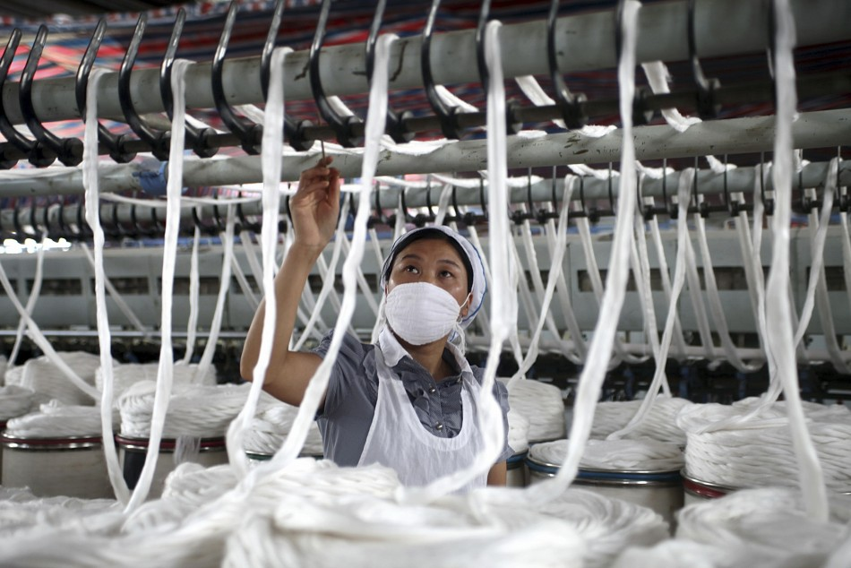 An employee works at a garment factory in China