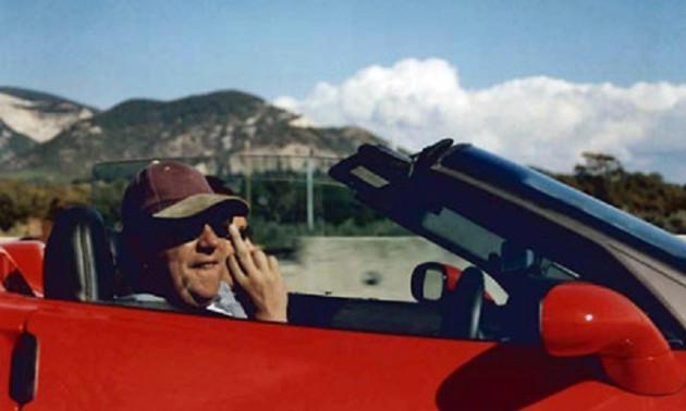 Richard Pope flips middle finger behind wheel of flash car
