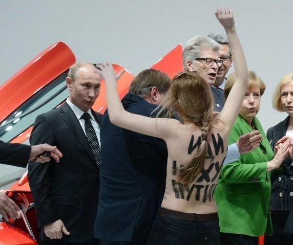 Femen activist confronts President Putin