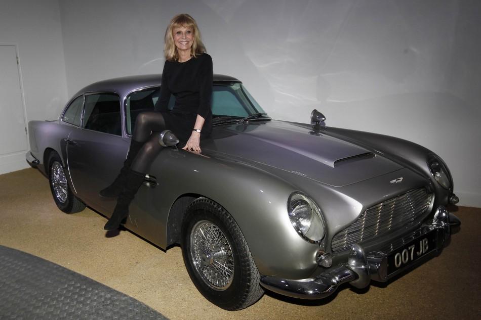 """Bond Girl"", Britt Ekland poses with an Aston Martin DB5"