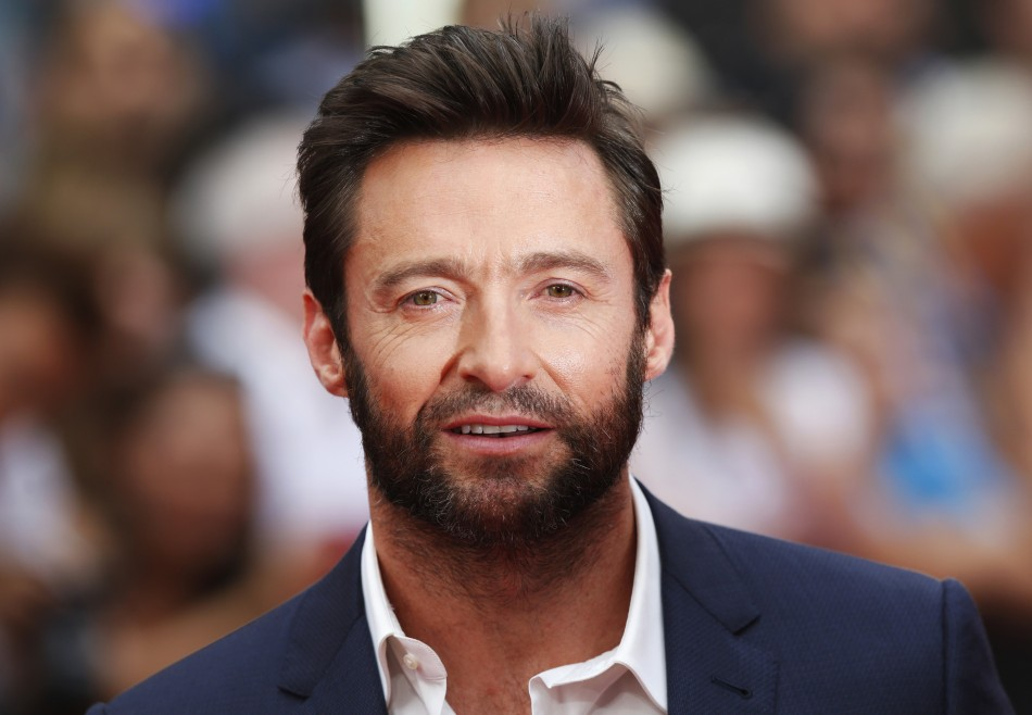Actor Hugh Jackman poses as he arrives at the UK Premiere of The Wolverine at Leicester Square in London