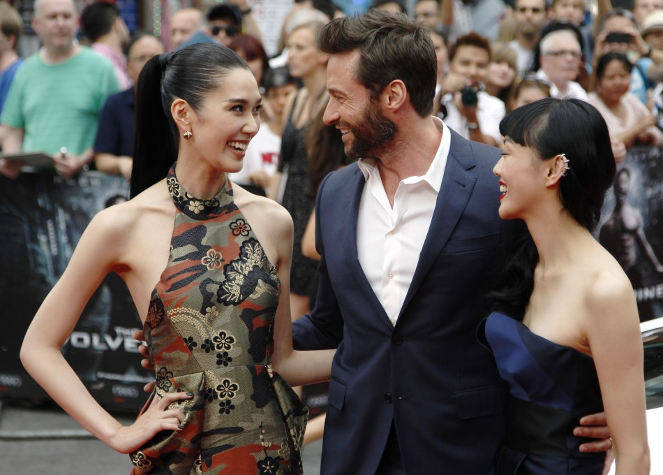 Actor Hugh Jackman poses with Tao Okamoto L and Rila Fukushima R at the UK Premiere of The Wolverine at Leicester Square in London