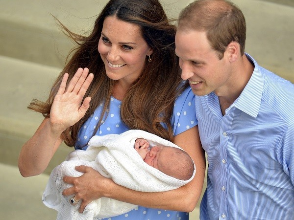 Kate Middleton holding Prince George, who is third in line to the British throne.