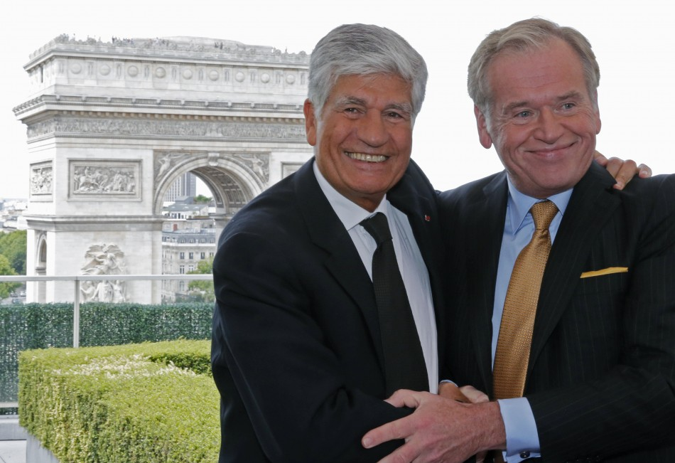 Maurice Levy (L) , French advertising group Publicis chief executive, and John Wren, head of Omnicom Group, have announced merger plans to create the world's biggest advertising group.