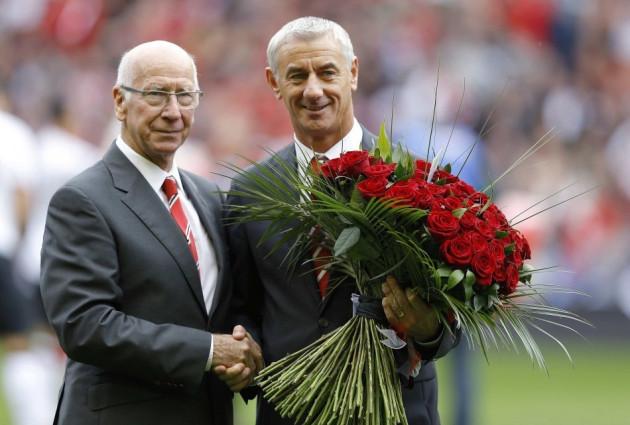 Sir Bobby Charlton (L)