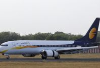 A Jet Airways passenger plane moves on the runway at a domestic airport in India.