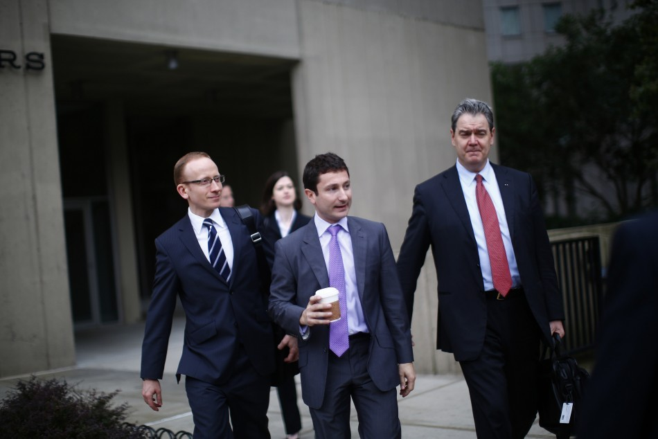 Frenchman Fabrice Tourre (C) arrives at the Manhattan Federal Court in New York, on 26 July, 2013.