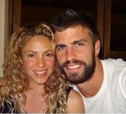 Shakira poses with boyfriend Gerard on a private vacation