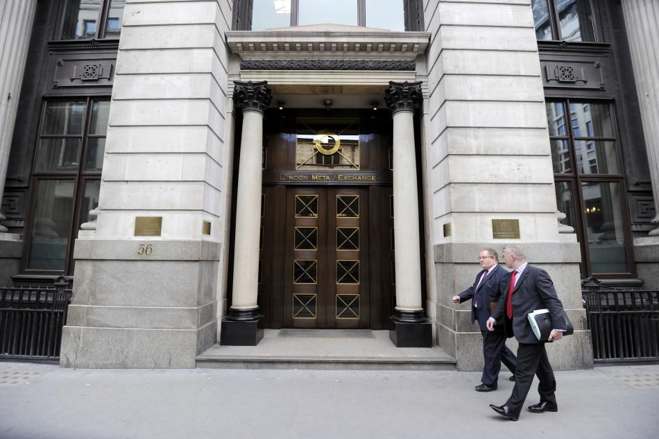 Men walk past the London Metal Exchange (LME) in London