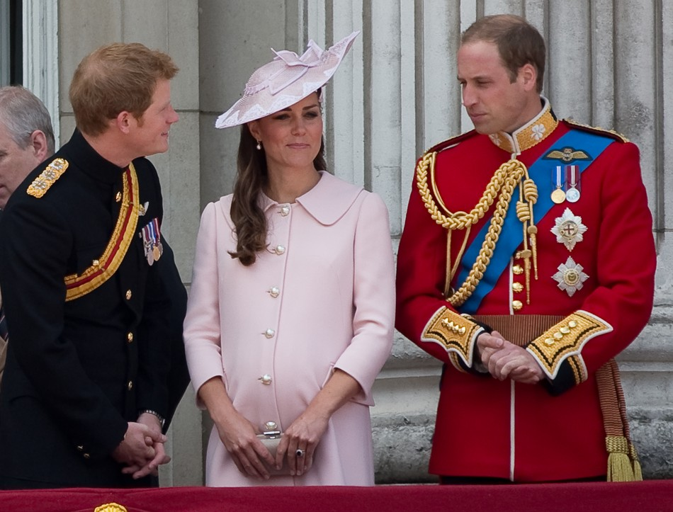 Prince Harry, Prince William and Catherine, Duchess of Cambridge stand on the balcony of Buckingham Palace after the Trooping the Colour ceremony on 15 June, 2013. Kate's pink dress worn for the event has secured her a place in Vanity Fair's best-dressed list for 2013. (Photo: REUTERS/Paul Hackett)