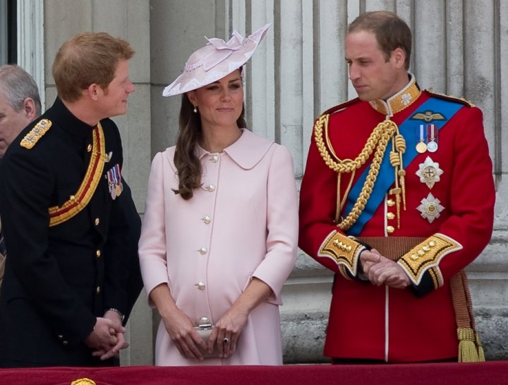 Prince Harry, Prince William and Catherine, Duchess of Cambridge stand on the balcony of Buckingham Palace after the Trooping the Colour ceremony on 15 June, 2013. Kate's pink dress worn for the event has secured her a place in Vanity Fair's best-dressed