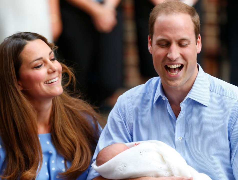 Prince William and his wife Catherine, Duchess of Cambridge appear with their baby son