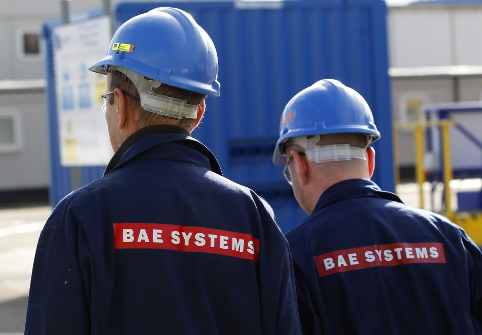 BAE Systems employees walk together at Roysth naval yard in Rosyth, Scotland.