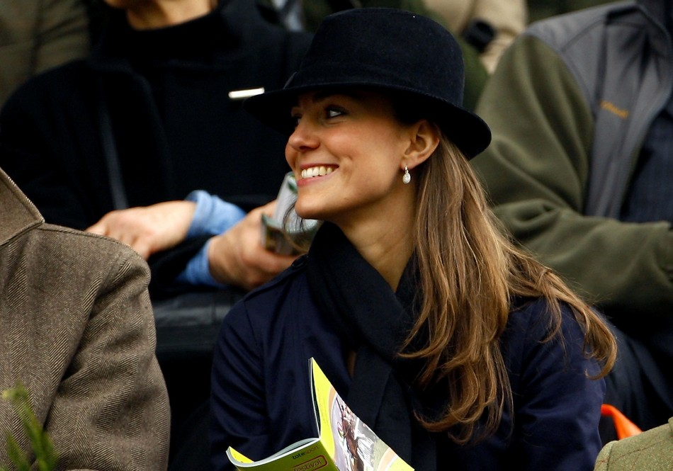 Tailored jackets, boots, and Philip Treacy hats gave Kate Middleton inaugural entry to Vanity Fair's best-dressed list in 2008. Kate, then the girlfriend of Prince William, is pictured here at the 2008 Cheltenham Festival horse racing meeting in Gloucestershire.
