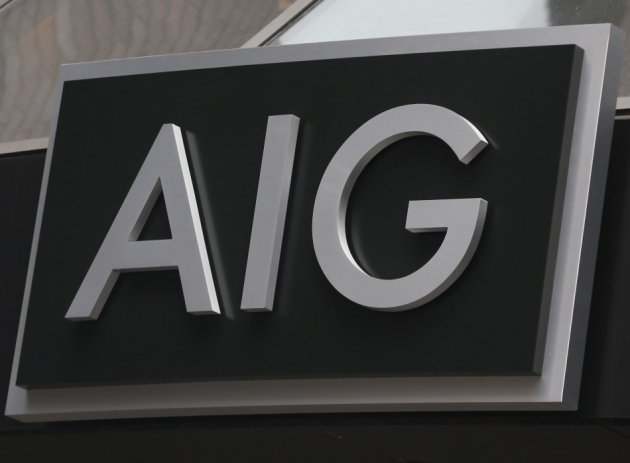 A new sign is displayed over the entrance to the AIG headquarters offices in New York's financial district.