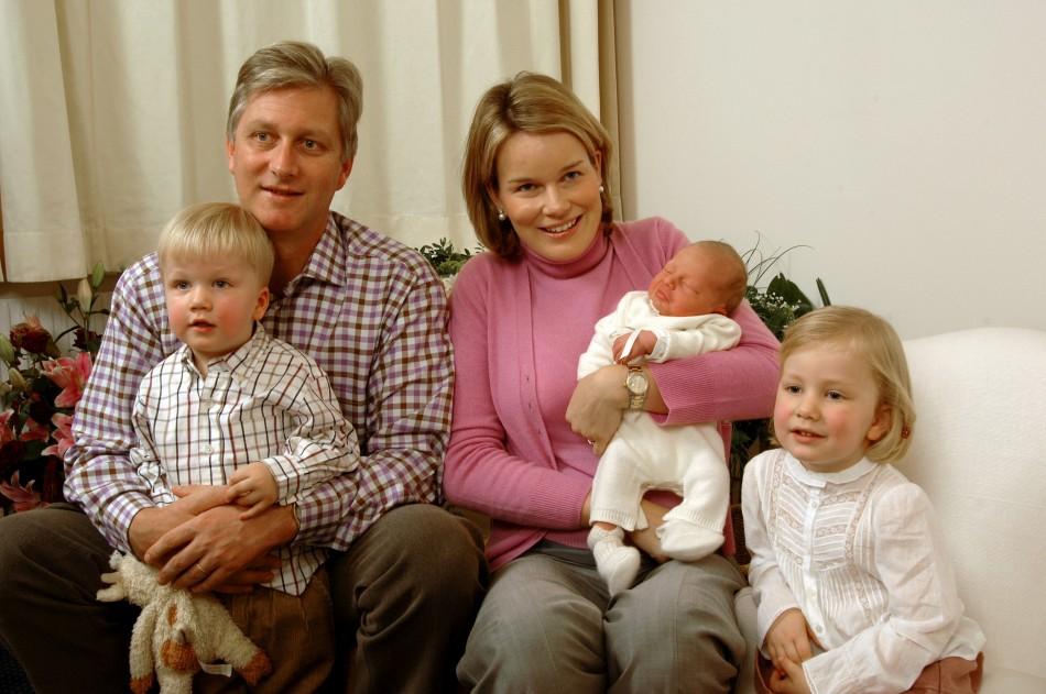 Belgian Prince Gabriel (L) and Princess Elisabeth (R) sit next to their parents, the then Crown Prince Philippe (2ndL) and his wife Princess Mathilde (C) as they pose for a family photo with their new brother Prince Emmanuel at the maternity at Erasmus ho